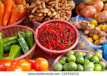 Colorful vegetables with peppers and lemons at the greengrocer on the market i n Sapa inVietnam - stock photo