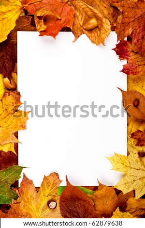 Colorful vertical frame of fallen autumn leaves chestnuts and acorns - stock photo
