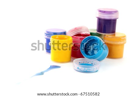 Colorful vibrant cans of gouache isolated on white