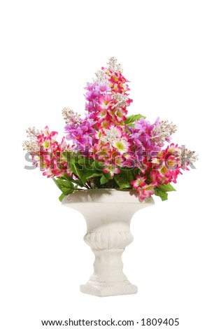 Colorful vibrant flowers in a stone vase