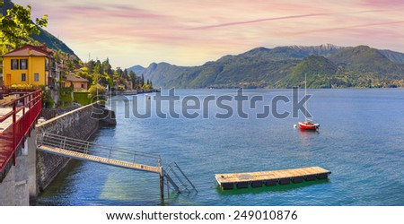 Colorful view of the typical italian village in the mountains. Italian village Limonta in Lecco Lake. Lombardy, Italy. - stock photo