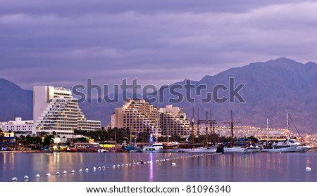 Colorful view on northern beach of the Red Sea in Eilat - famous resort and recreation town in Israel - stock photo