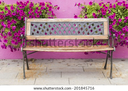 Colorful vintage chair with flowers behind europe style.