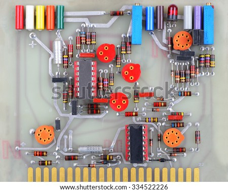 Colorful vintage printed circuit board. - stock photo