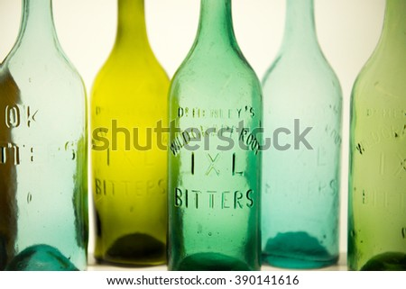 Colorful vintage therapeutic wild grape root bitters bottles - stock photo