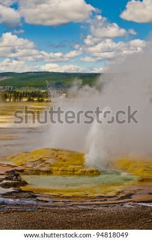 Colorful vivid vertical shot of a erupting yellowstone geyser - stock photo