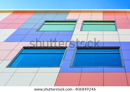colorful wall with colofull windows at the modern buildings on a bright sunny day