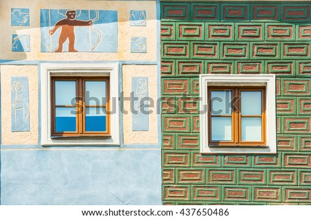 Colorful walls of polish houses with ornaments closeup in Poznan - stock photo