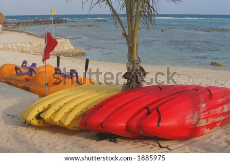 Colorful water equipment on the beach. - stock photo
