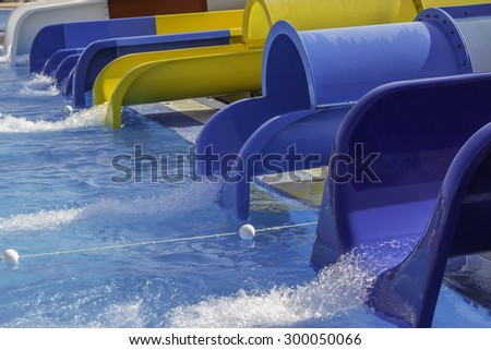 Colorful water slides at the aqua park.  Selective focus and shallow dof. - stock photo