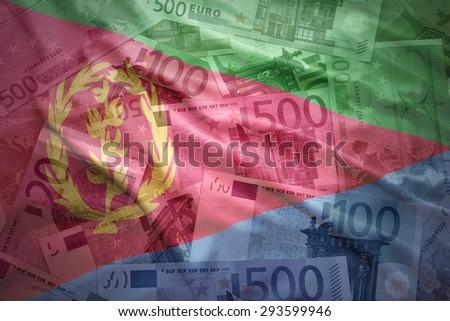 colorful waving eritrean flag on a euro money background - stock photo