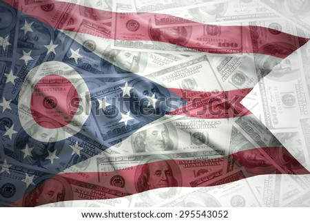 colorful waving ohio state flag on a american dollar money background