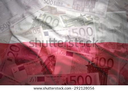 colorful waving polish flag on a euro money background - stock photo