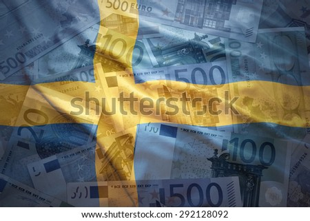 colorful waving swedish flag on a euro money background - stock photo