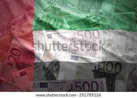 colorful waving united arab emirates flag on a euro money background - stock photo