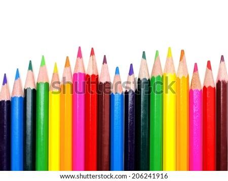 Colorful wavy pencil crayon border over white  - stock photo