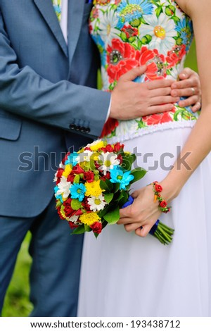 Colorful wedding bouquet in hands of the bride