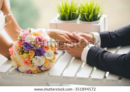 colorful wedding bouquet on table - stock photo
