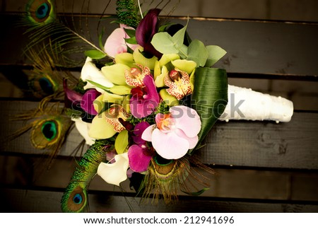 Colorful wedding bouquet with peacock feathers �¼ vintage photo - stock photo