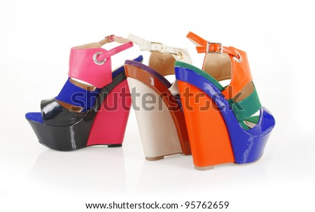 colorful wedge shoes isolated on white