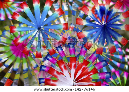 colorful windmills on background - stock photo