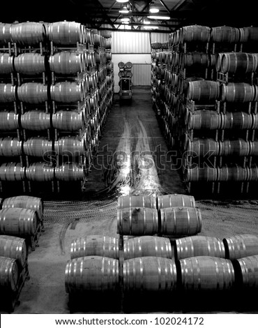 Colorful wine barrels fill the warehouse of a Napa Valley vineyard. - stock photo