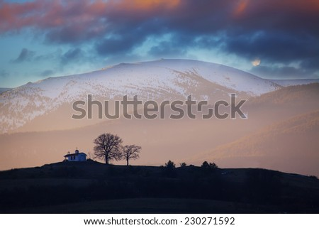 Colorful winter HDR down over the small mountain church in bulgaria - stock photo