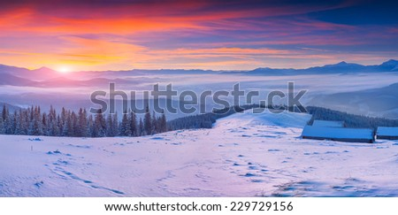 Colorful winter panorama of the Carpathian mountains at sunrise - stock photo