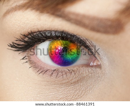 Colorful woman eye close-up - stock photo