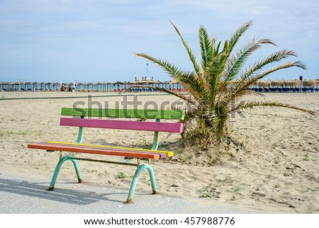 Colorful wooden bench on the promenade by the sea coast