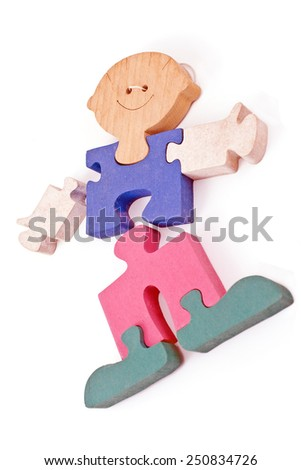 Colorful wooden boy puzzle pieces isolated on white - stock photo