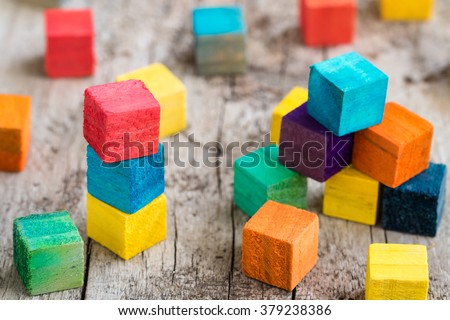 Colorful wooden building blocks. Selective focus - stock photo