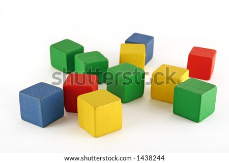 colorful wooden childen's building blocks scattered loose - stock photo