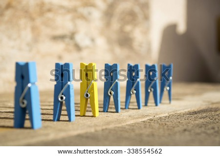 colorful wooden clothespin. selective focus image. be different concept - stock photo