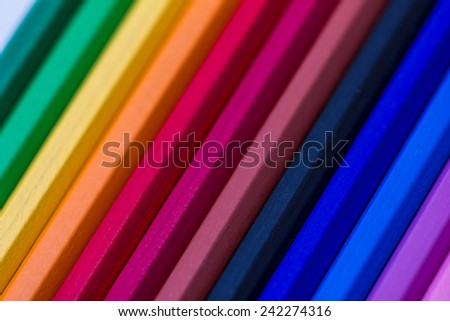 Colorful wooden crayons, pencils - stock photo