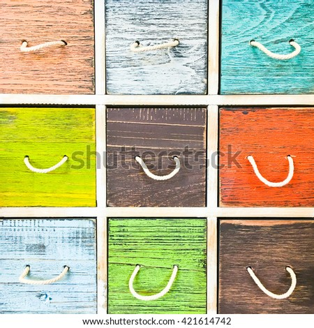 Colorful wooden drawers on a wooden cabinet - stock photo