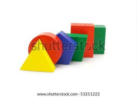 Colorful wooden geometric blocks on white background - stock photo