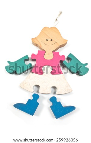 Colorful wooden girl puzzle pieces isolated on white - stock photo