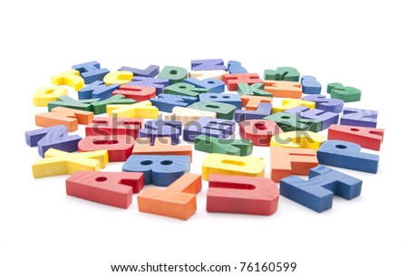 Colorful wooden letters on white background - stock photo