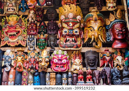 Colorful wooden masks and handicrafts on sale at shop in the Thamel District of Kathmandu, Nepal. - stock photo