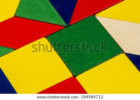 Colorful wooden pieces for tangram technique - stock photo