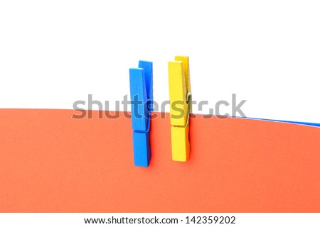 Colorful wooden pin with paper and copy space - stock photo