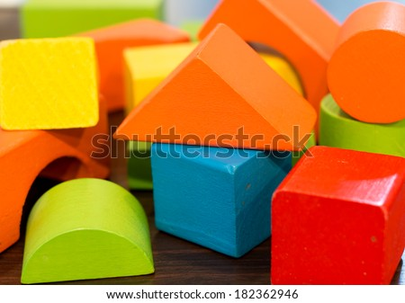 Colorful wooden toy building blocks - stock photo