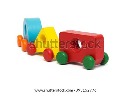 Colorful wooden toy cars isolated on white background