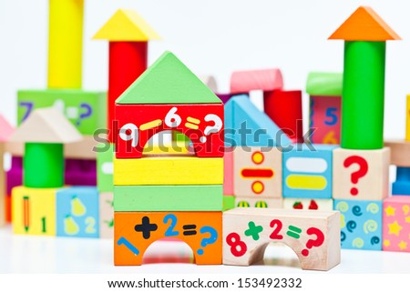 Colorful wooden toy castle - stock photo