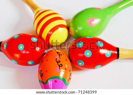 colorful wooden toy maracas music percussion instrument for kid and children play on white background closeup view - stock photo