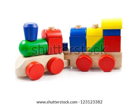 Colorful wooden toy train isolated on white background - stock photo