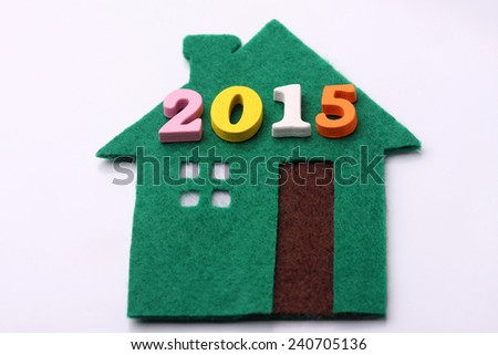 colorful word 2015 on green house - stock photo