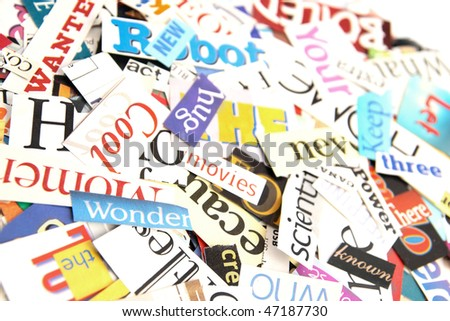 Colorful words cut out from magazines form an attractive background - stock photo