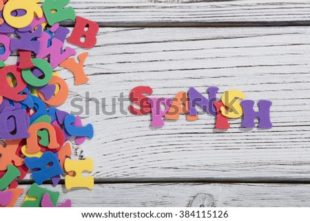 colorful words spanish on white wooden background - stock photo